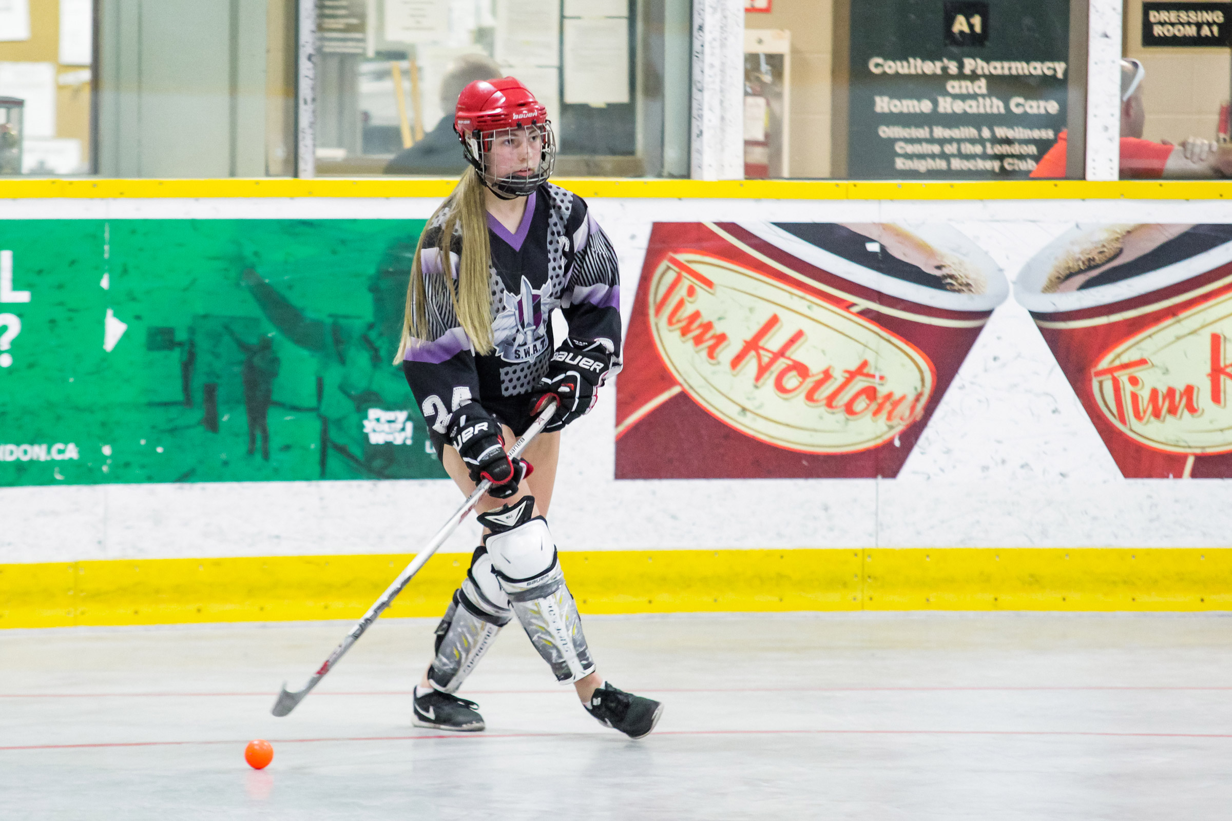 woman playing bal hockey