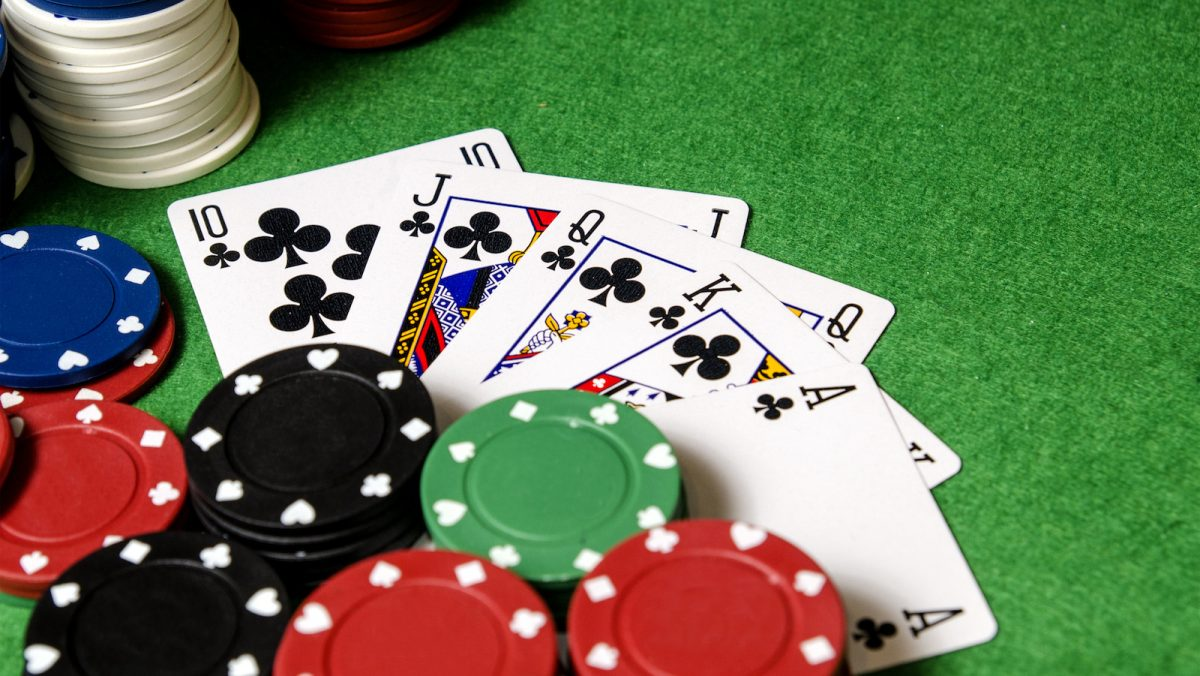 royal flush of sahamrocks between betting chips